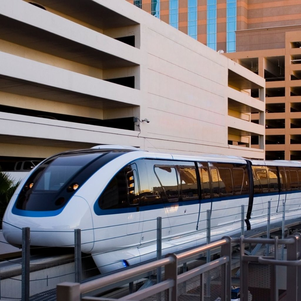 Photo of the Las Vegas Monorail gliding between hotel buildings.