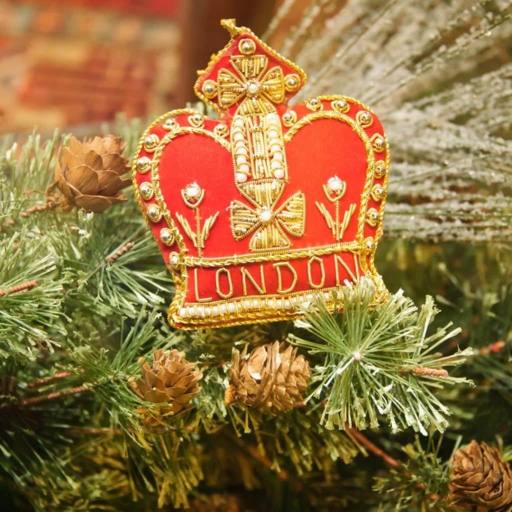 Closeup of a London crown ornament on a Christmas tree.