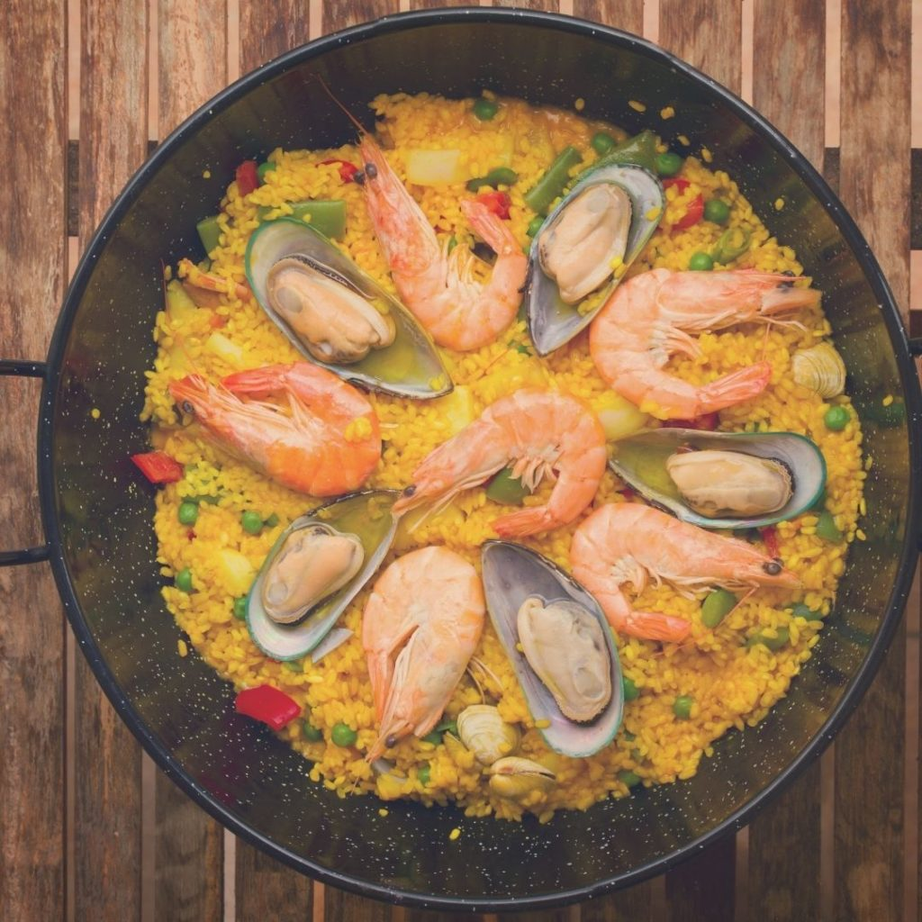 Closeup of a pan filled with paella from Barcelona, Spain.