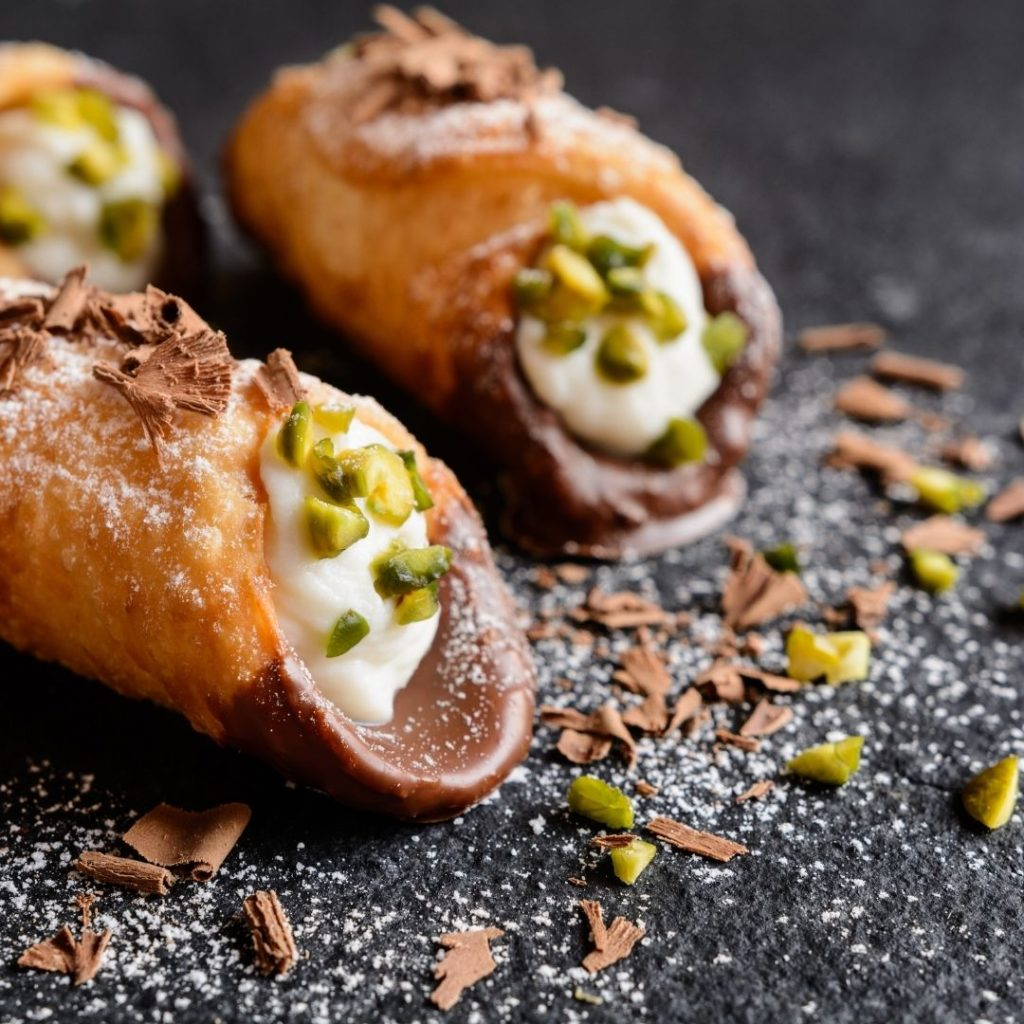 Closeup of cannoli with chocolate shaving an pistachio crumbs.