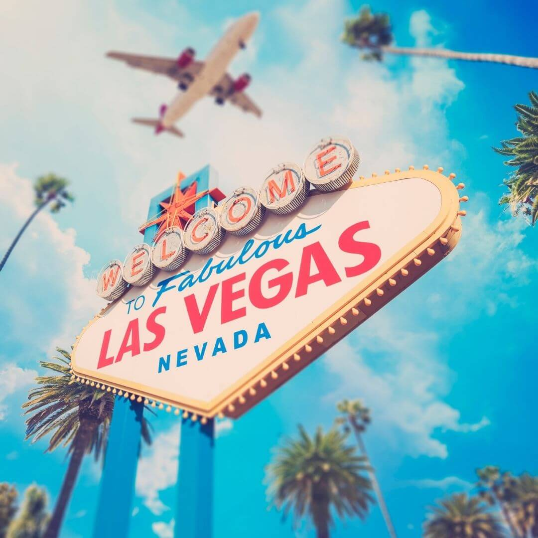 """Photo of the iconic Welcome to Fabulous Las Vegas Nevada"""" sign with a plane flying overhead."""
