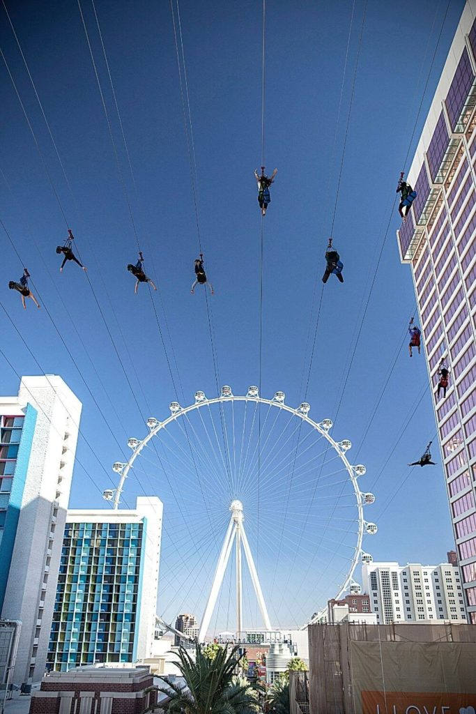 Photo of the LINQ Promenade zipline, pointed toward the High Roller ferris wheel.
