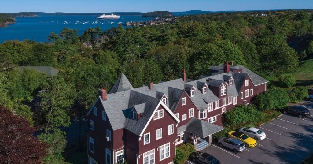 Aerial photo of Cleftstone Manor of Bar Harbor with Frenchman Bay in the background.