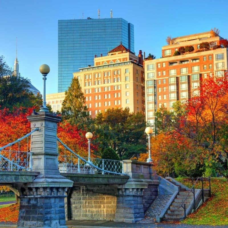 Photo of Boston Public Garden in the Fall with red and orange Fall foliage.