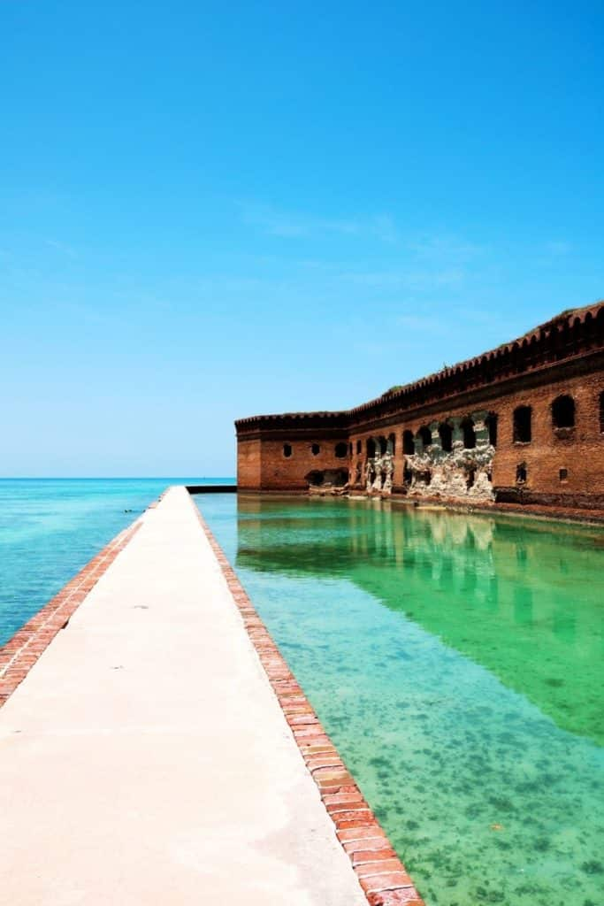 Photo of a walkway parallel to Fort Jefferson at Dry Tortugas National Park in Florida.