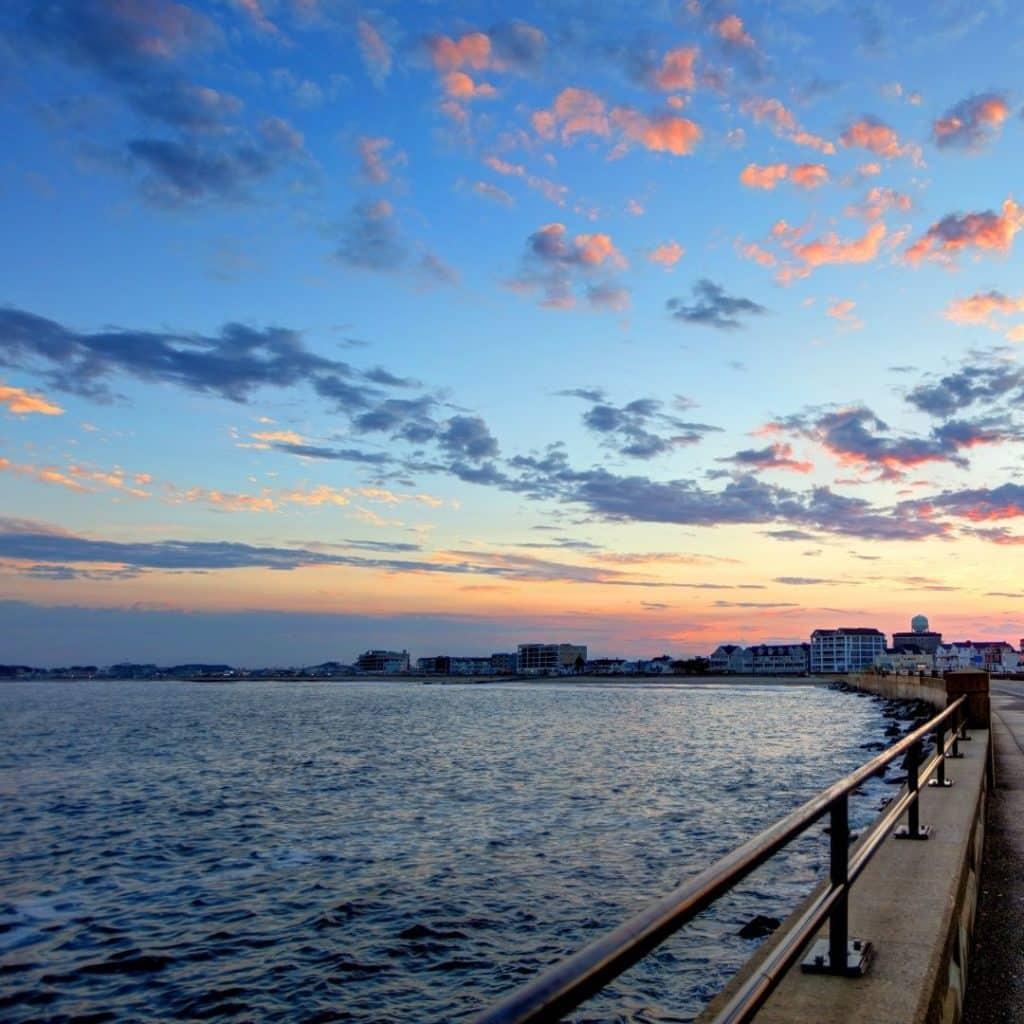 Photo of the walkway along Hampton Beach in New Hampshire at sunrise.