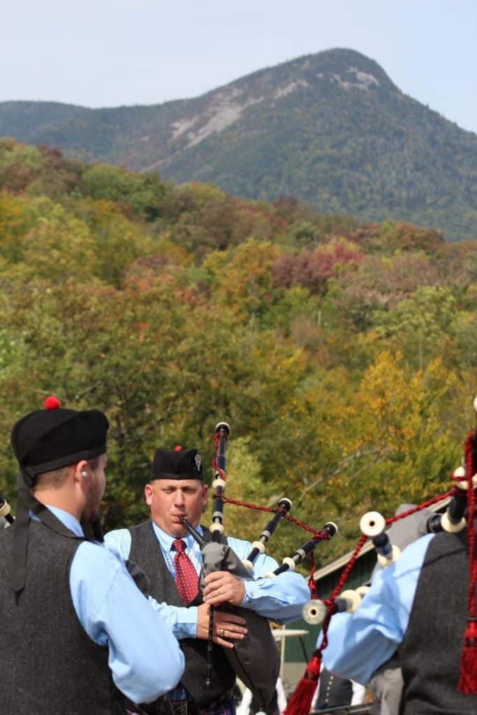 Photo of a group of men playing the bagpipes.