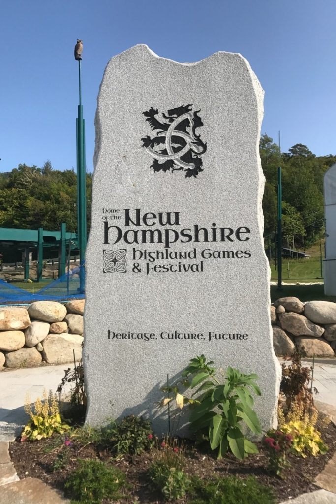 Photo of a stone slab with an engraving for the New Hampshire Highland Games & Festival.