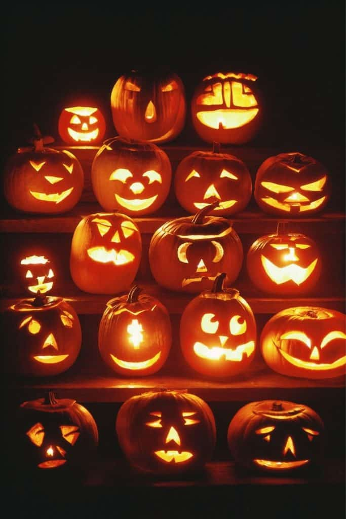Close up photo of jack-o-lanterns light up over a series of 5 steps.