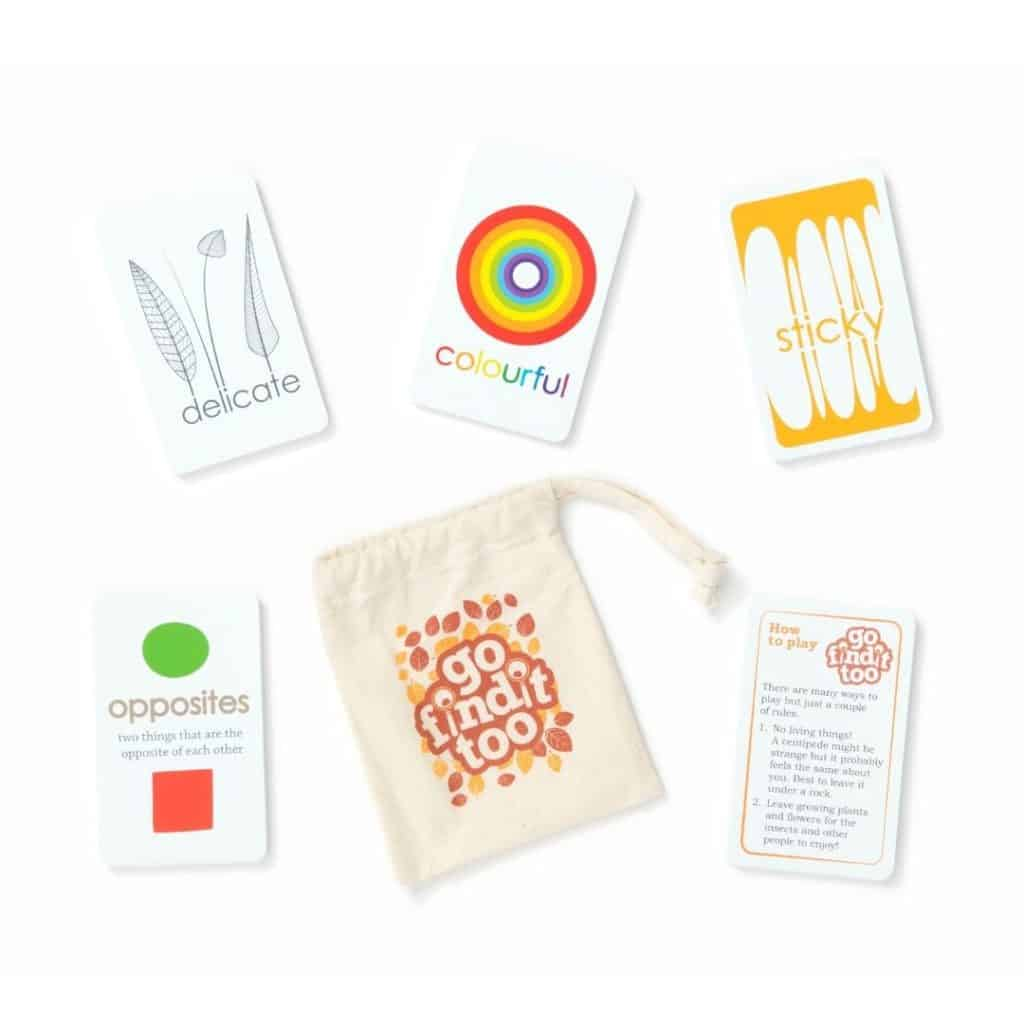 Flatlay with scavenger hunt cards and an orange pouch.