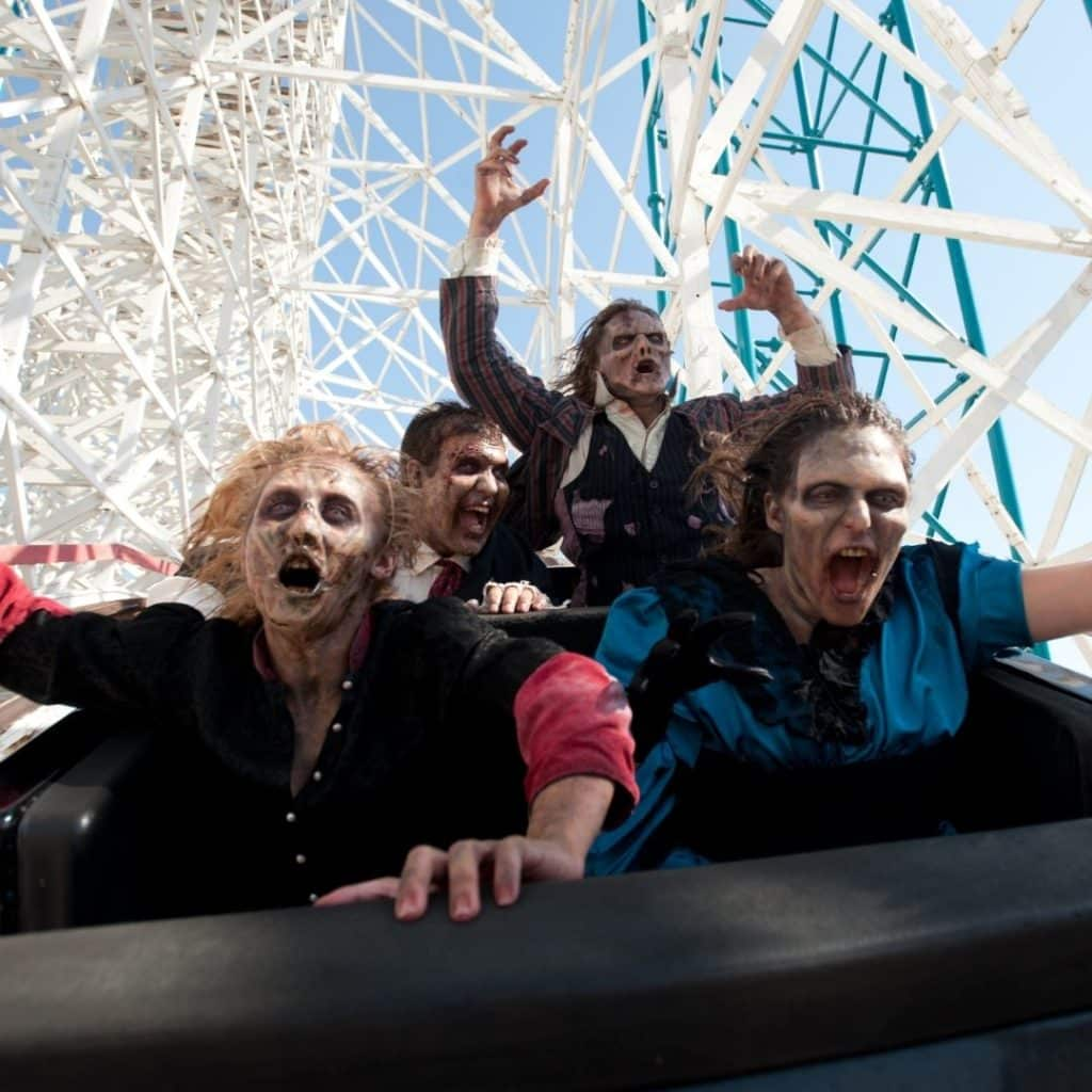 Photo of zombies riding a roller coaster at Six Flags Great Escape in New York.