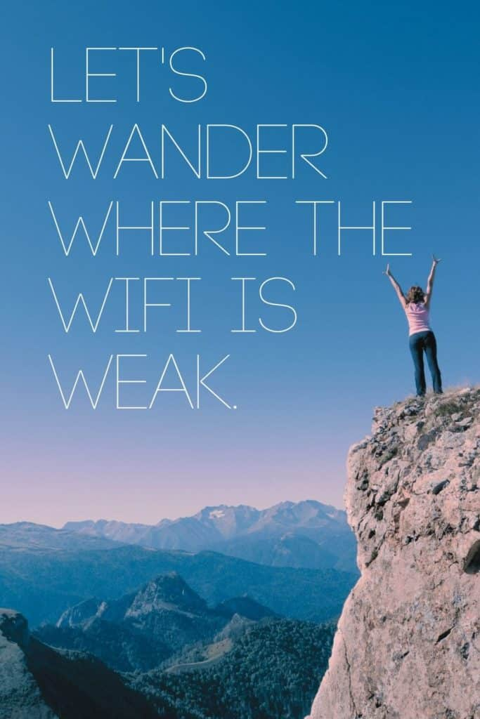 """Photo of a woman standing triumphantly on top of a mountain overlooking a valley with more mountains in the background. Text overlay reads """"Let's wander where the WiFi is weak."""""""