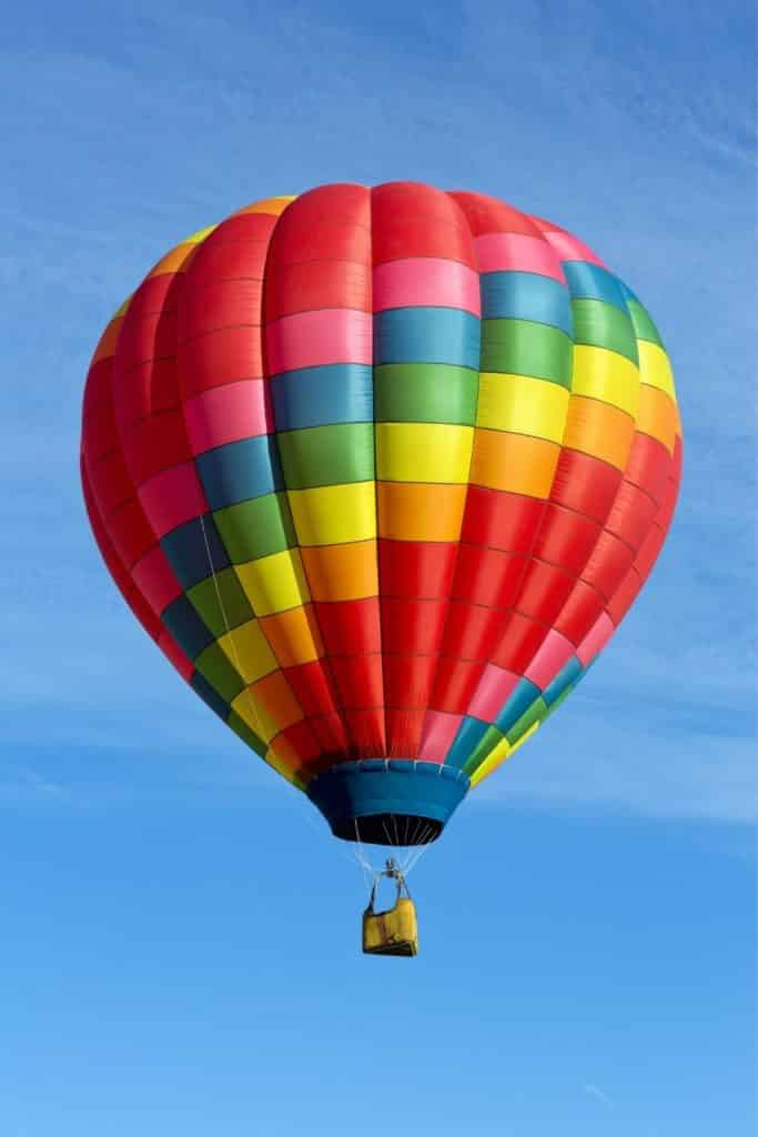 Photo of a colorful hot air balloon in the air.