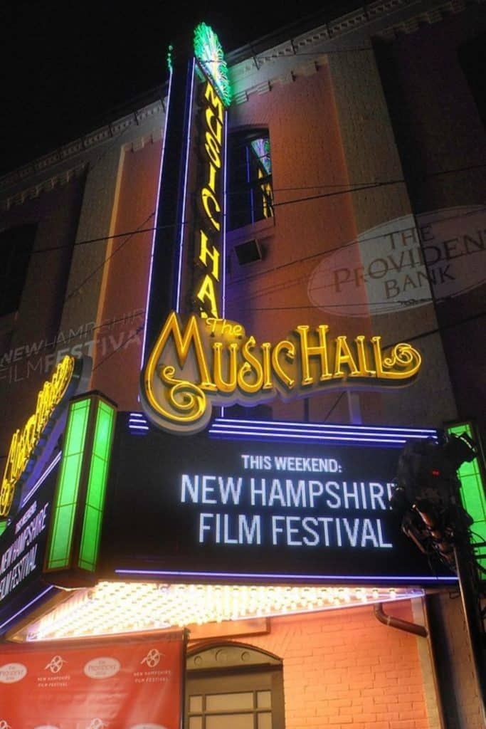"""Photo of a music hall marquee lit up at night that says """"This Weekend: New Hampshire Film Festival."""""""