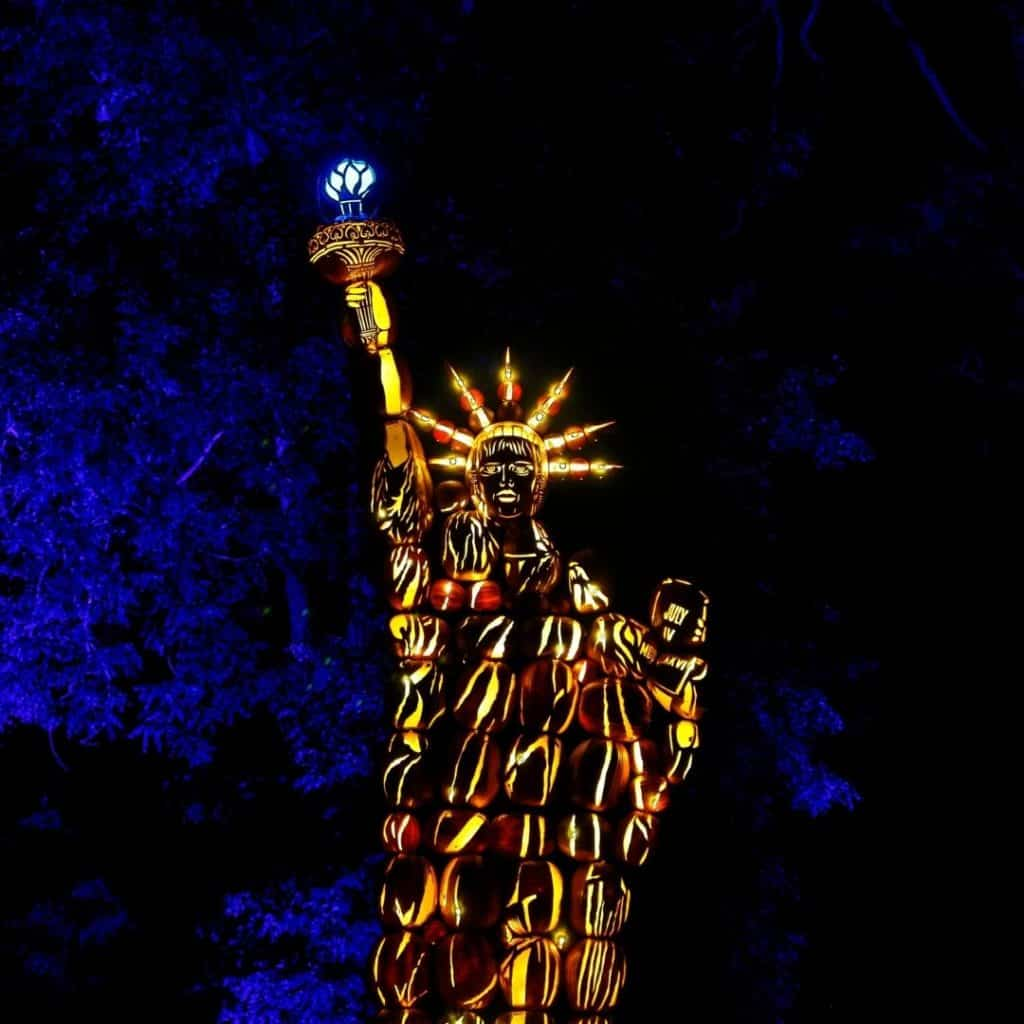 Photo of a replica of the Statue of Liberty made out of carved pumpkins.