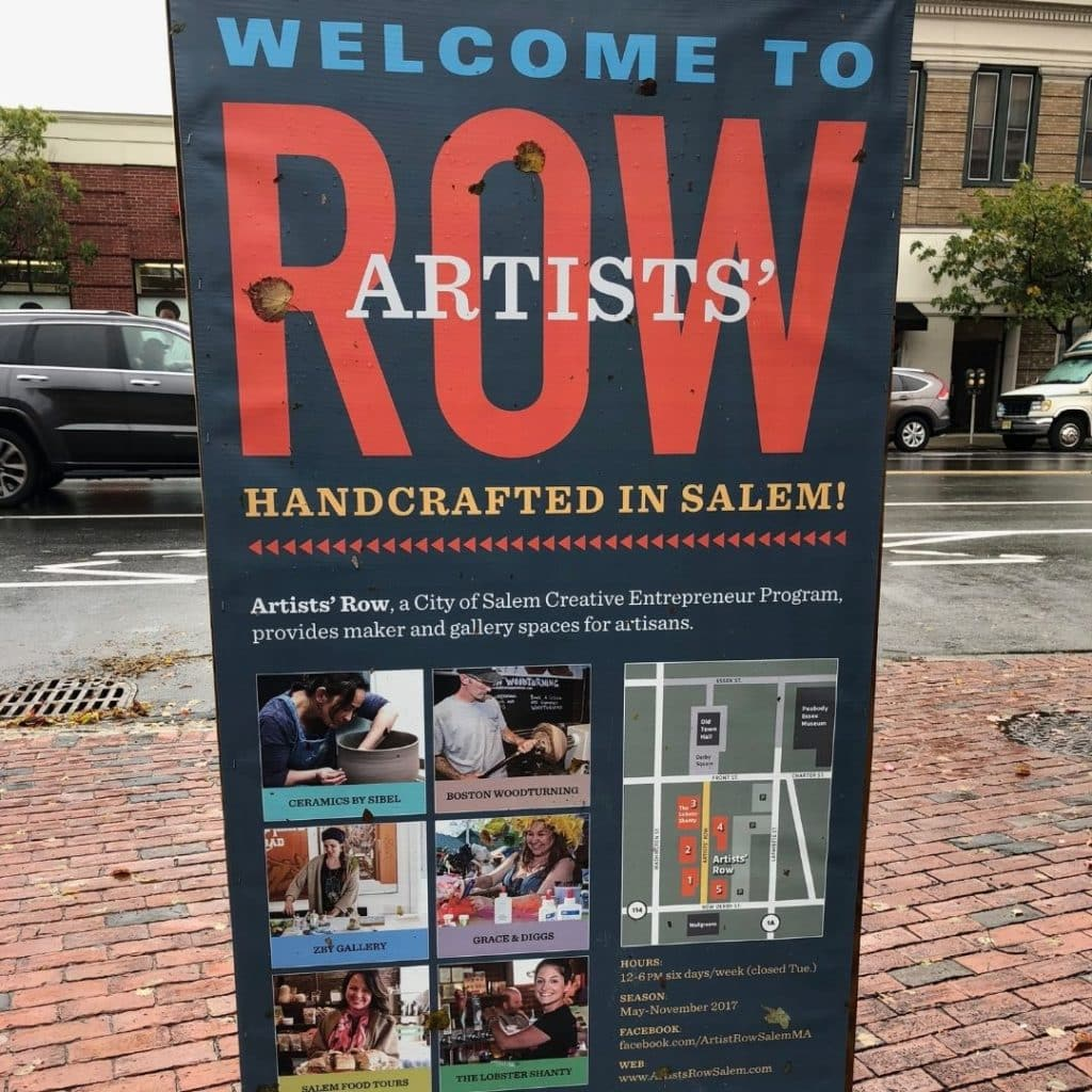 Photo of a sign advertising Artists' Row in Salem, MA.
