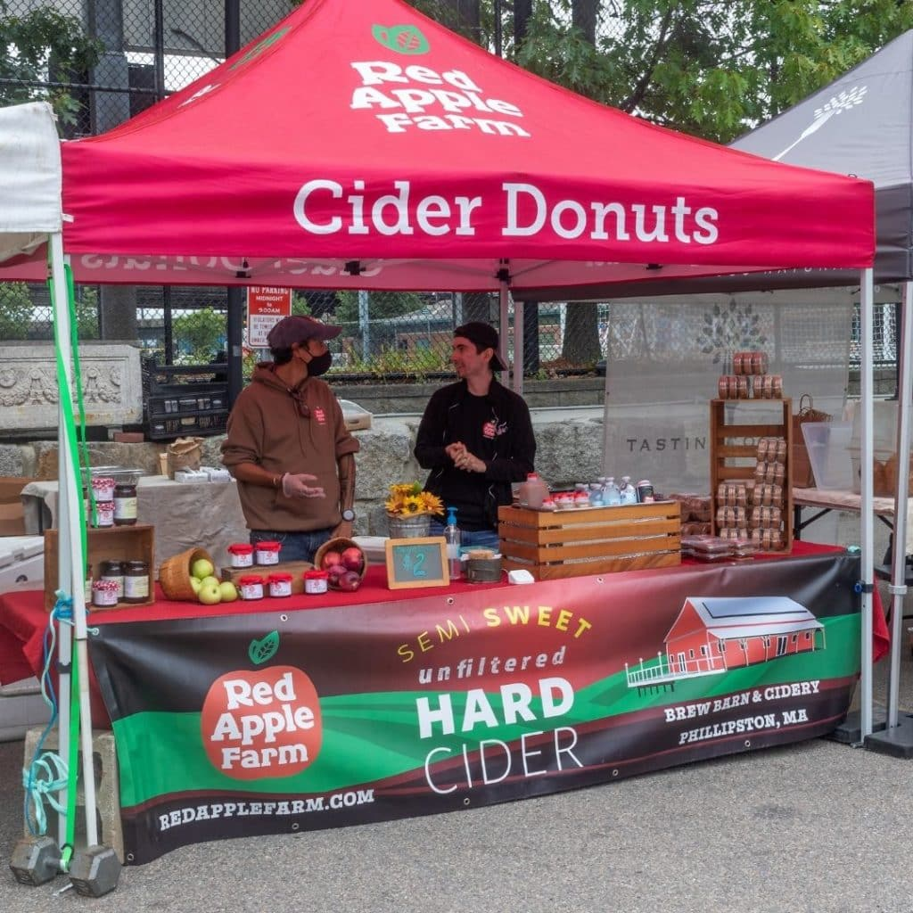 Photo of the Red Apple Farm market tent at SoWa Boston.