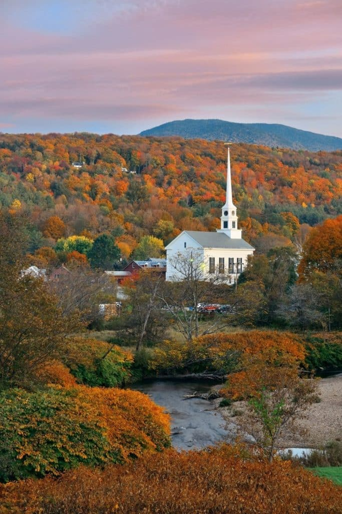 Photo of the Fall landscape in Stowe, Vermont, with a white church in the midground.