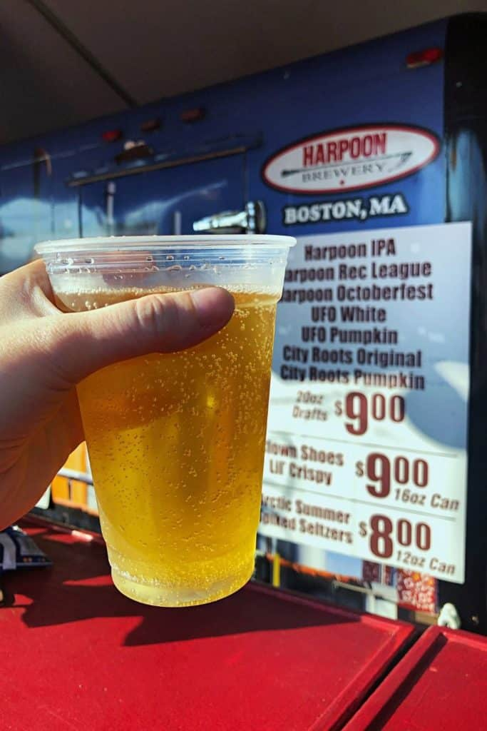 Closeup of a cup of hard pumpkin cider from Harpoon Brewery booth at The Big E.