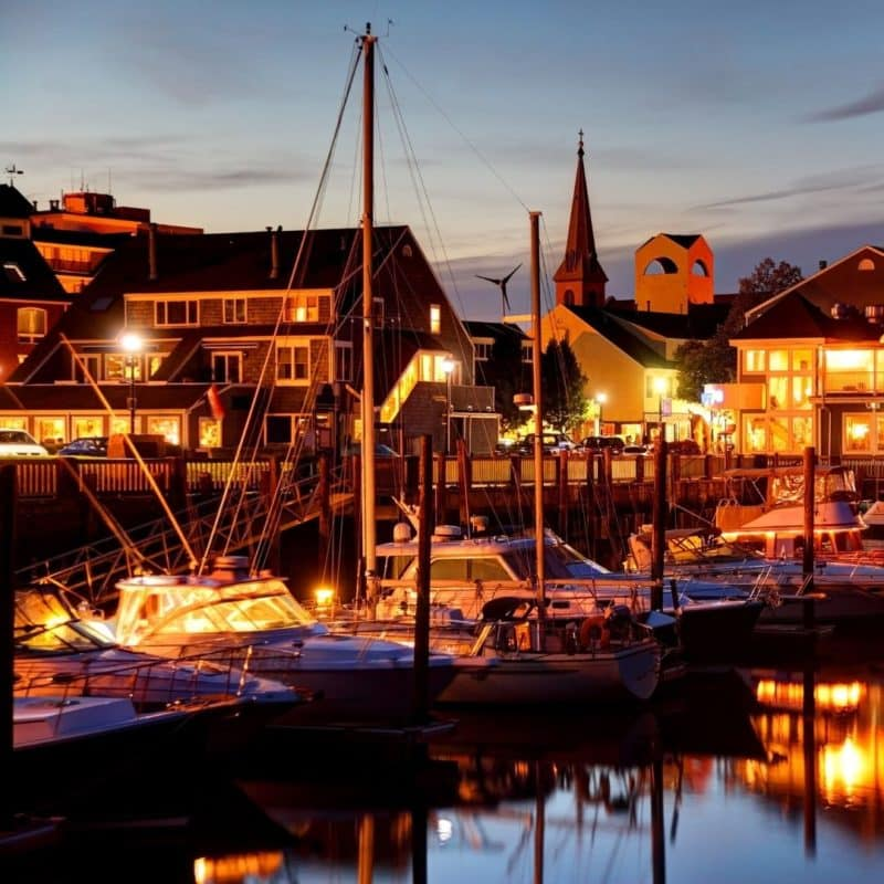 Photo of the Salem waterfront with boats docked at night.