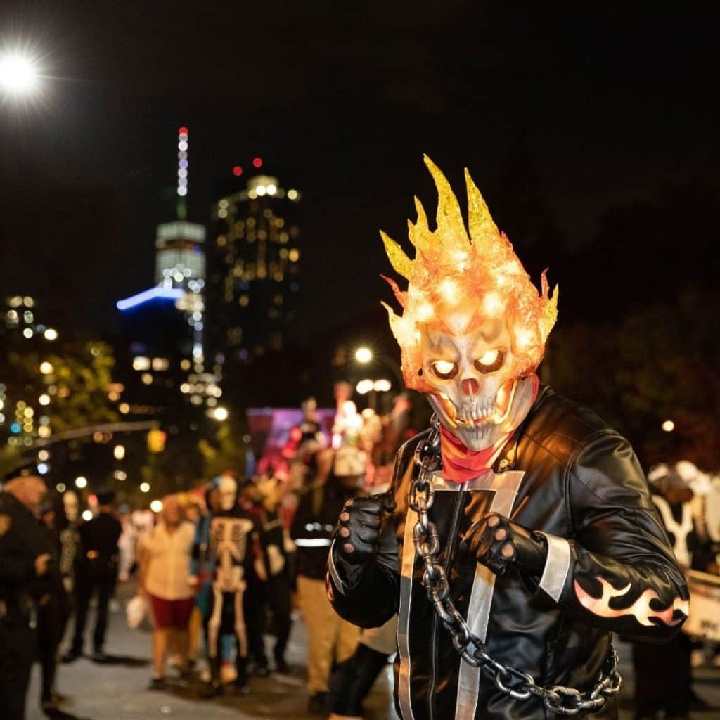 Photo of a person dressed as the Ghost Rider character with a flaming skull.