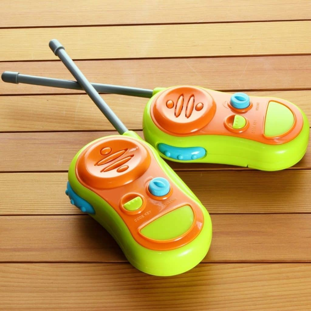 Closeup of 2 brightly colored walkie talkie radios for kids.