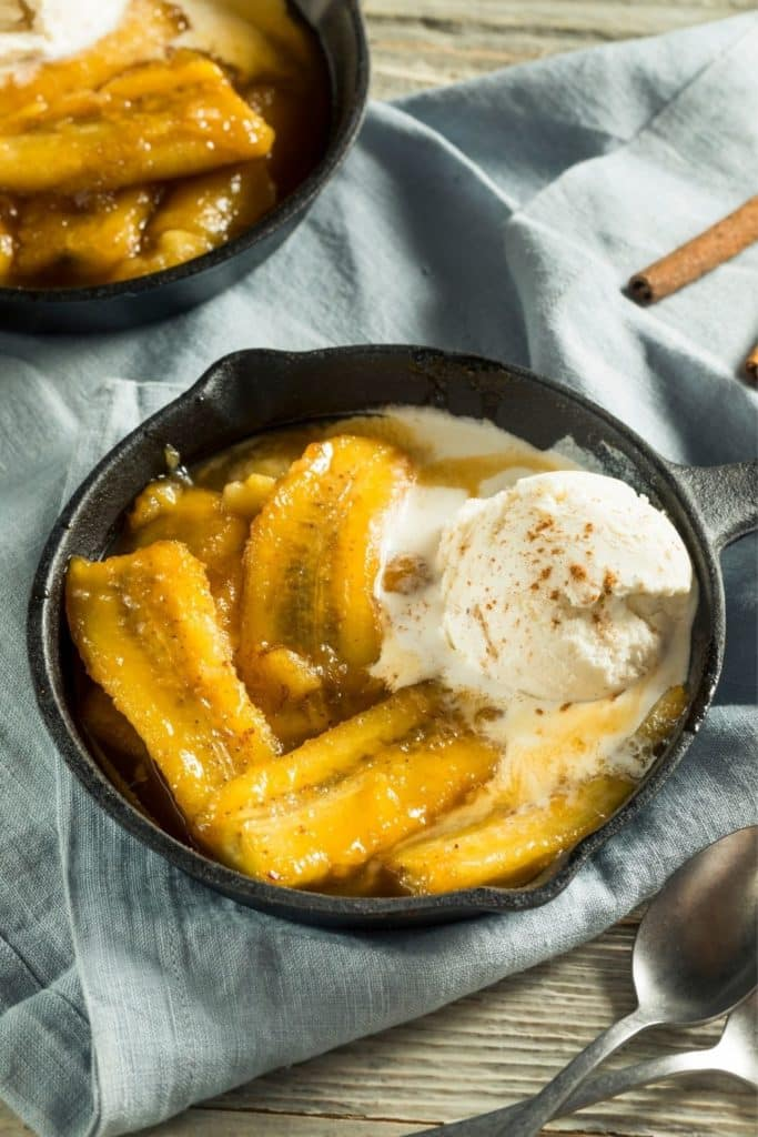 Photo of a small skillet with bananas foster sundae.