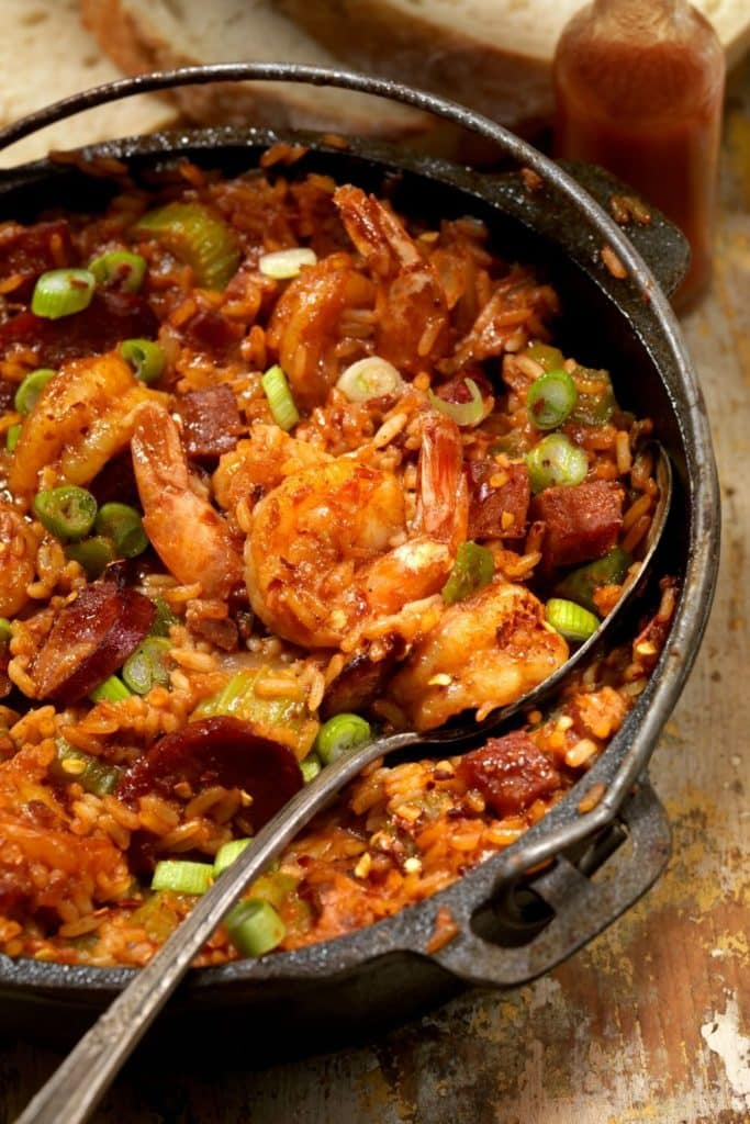 Photo of a large pot of jambalaya with shrimp and sausage.