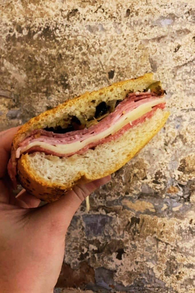 Closeup of a muffuletta sandwich from central grocery in New Orleans' French Quarter.