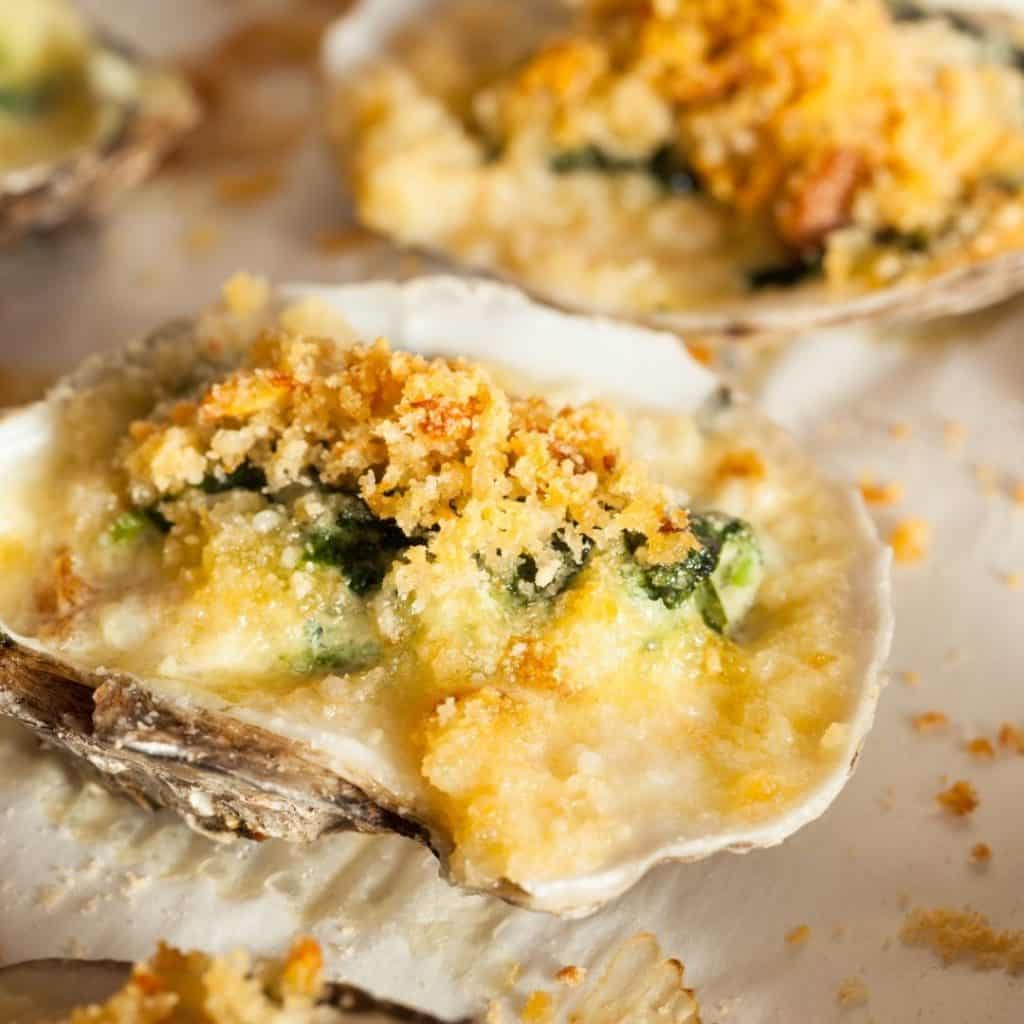 Closeup of oysters rockefeller.