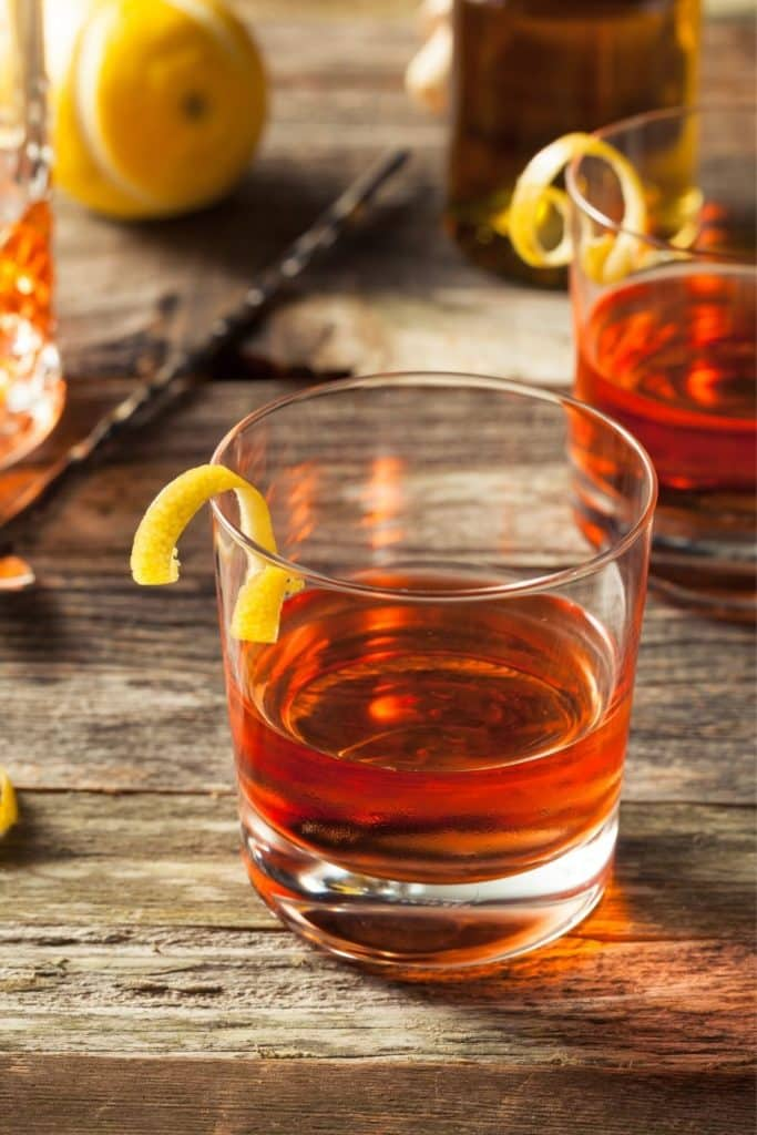 Closeup of a sazerac cocktail in a short glass.